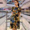 Đầm xòe cổ tròn tay phồng sắc vàng họa tiết hoa lá đen và xanh hình 1